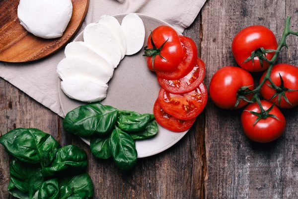 Food, cooking. Mozzarella with tomato on the table